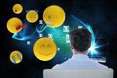 Composite image on businessman and smileys is 3d. Digital composite of Composite image on businessman and smileys is 3d Royalty Free Stock Images