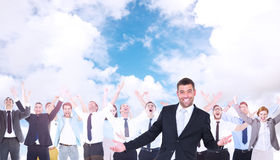 Composite image of businessman smiling with hands out Royalty Free Stock Image