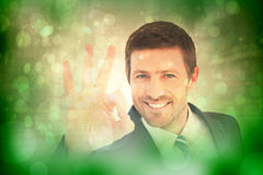 Composite image of businessman smiling and making ok sign Stock Photo