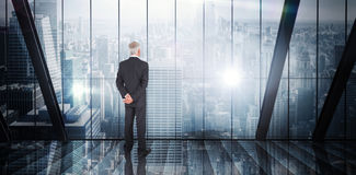 Composite image of businessman standing Royalty Free Stock Photo