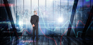 Composite image of businessman standing Stock Image