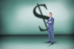 Composite image of businessman standing arms crossed over white background royalty free stock images