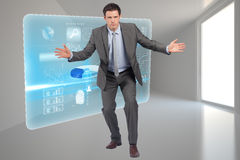 Composite image of businessman standing with arms out Stock Images