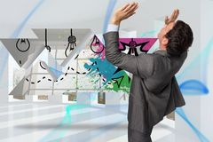 Composite image of businessman standing with arms pressing up Royalty Free Stock Image