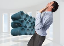 Composite image of businessman standing with arms pushing up Stock Photo
