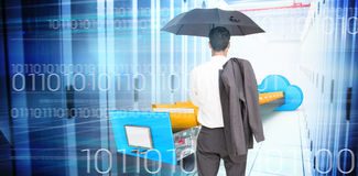 Composite image of businessman standing back to camera holding umbrella and jacket on shoulder Royalty Free Stock Photo