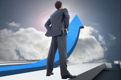 Composite image of businessman standing with hands on hips Stock Photography