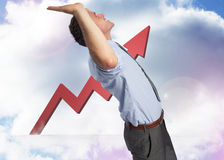 Composite image of businessman standing with hands up Stock Photos