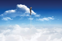 Composite image of businessman standing on ladder using binoculars Royalty Free Stock Images