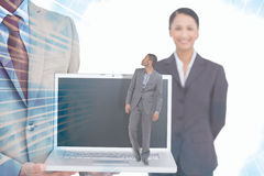 Composite image of businessman standing and looking Stock Image