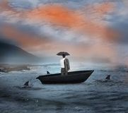 Composite image of businessman standing in a sailboat Royalty Free Stock Image