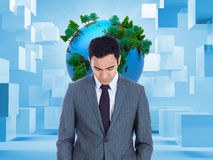 Composite image of businessman standing Stock Photo