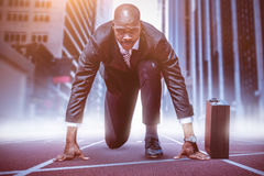 Composite image of businessman in the starting blocks royalty free stock images