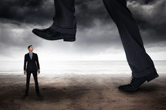 Composite image of businessman stepping. Businessman stepping against stormy weather by the sea royalty free stock photos