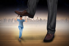 Composite image of businessman stepping on girl Stock Photo