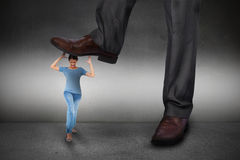 Composite image of businessman stepping on girl Royalty Free Stock Photo