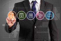 Composite image of businessman in suit pointing finger at menu Royalty Free Stock Photography