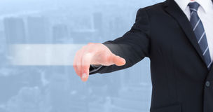 Composite image of businessman in suit pointing his finger royalty free stock photos