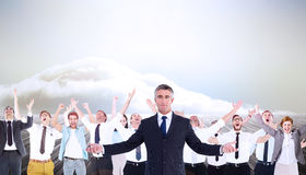 Composite image of businessman in suit spreading his arms Royalty Free Stock Photos