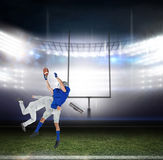 Composite image of businessman tackling a football player Royalty Free Stock Images