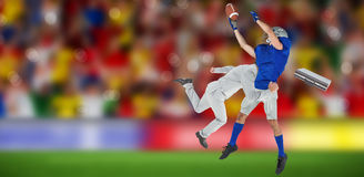 Composite image of businessman tackling a football player Royalty Free Stock Photos