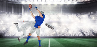 Composite image of businessman tackling a football player Stock Photo