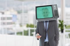 Composite image of businessman and television. Digital composite of Composite image of businessman and television Royalty Free Stock Photos
