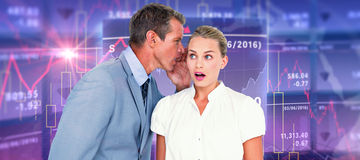 Composite image of  businessman telling secret to a businesswoman Stock Images