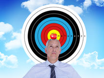 Composite image of businessman thinking. Businessman thinking against blue sky stock photography