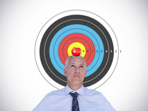 Composite image of businessman thinking. Businessman thinking against red apple stock photo