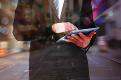 Composite image of businessman touching his tablet pc Royalty Free Stock Photo