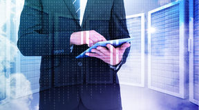 Composite image of businessman touching his tablet pc Stock Images