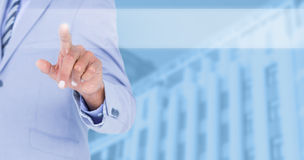Composite image of businessman touching invisible screen Royalty Free Stock Image