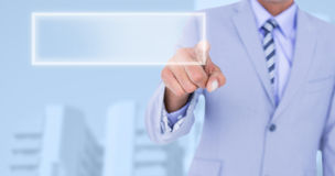 Composite image of  businessman touching invisible screen Stock Photo