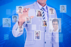 Composite image of businessman touching invisible screen Royalty Free Stock Photo