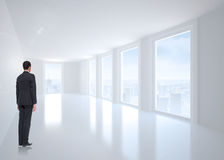 Composite image of businessman turning his back to camera Stock Photo