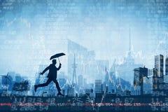 Composite image of businessman with umbrella Stock Photo