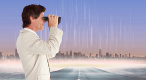 Composite image of businessman using binoculars Stock Image