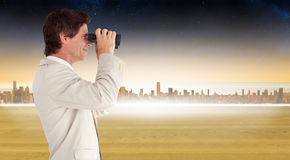Composite image of businessman using binoculars Royalty Free Stock Photos