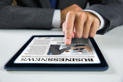 Composite image of businessman using digital tablet Royalty Free Stock Photo