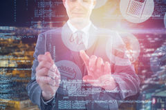 Composite image of businessman using futuristic digital tablet 3d Royalty Free Stock Photography