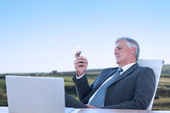 Composite image of businessman using his smartphone Stock Images