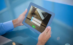 Composite image of businessman using his tablet Royalty Free Stock Image