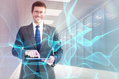 Composite image of businessman using his tablet pc Royalty Free Stock Photo