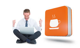 Composite image of businessman using laptop and cheering Royalty Free Stock Photos