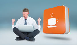 Composite image of businessman using laptop and cheering Royalty Free Stock Images