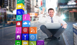 Composite image of businessman using laptop and cheering Royalty Free Stock Image