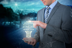 Composite image of businessman using mobile phone Stock Images