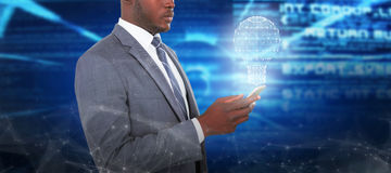 Composite image of businessman using smart phone Royalty Free Stock Photos