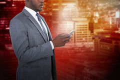 Composite image of businessman using smart phone Stock Images